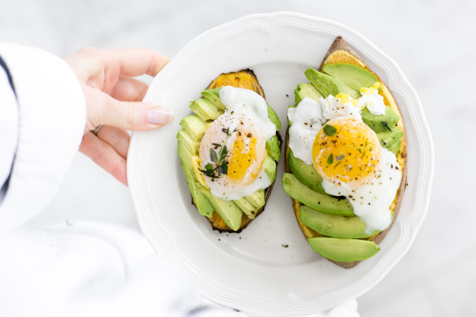 Sweet potato toast with avocado and poached egg